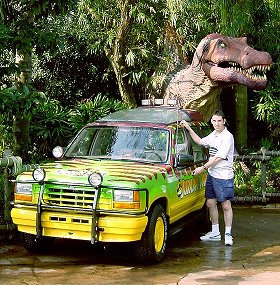 Paul Denton with dinosaur at Jurassic Park